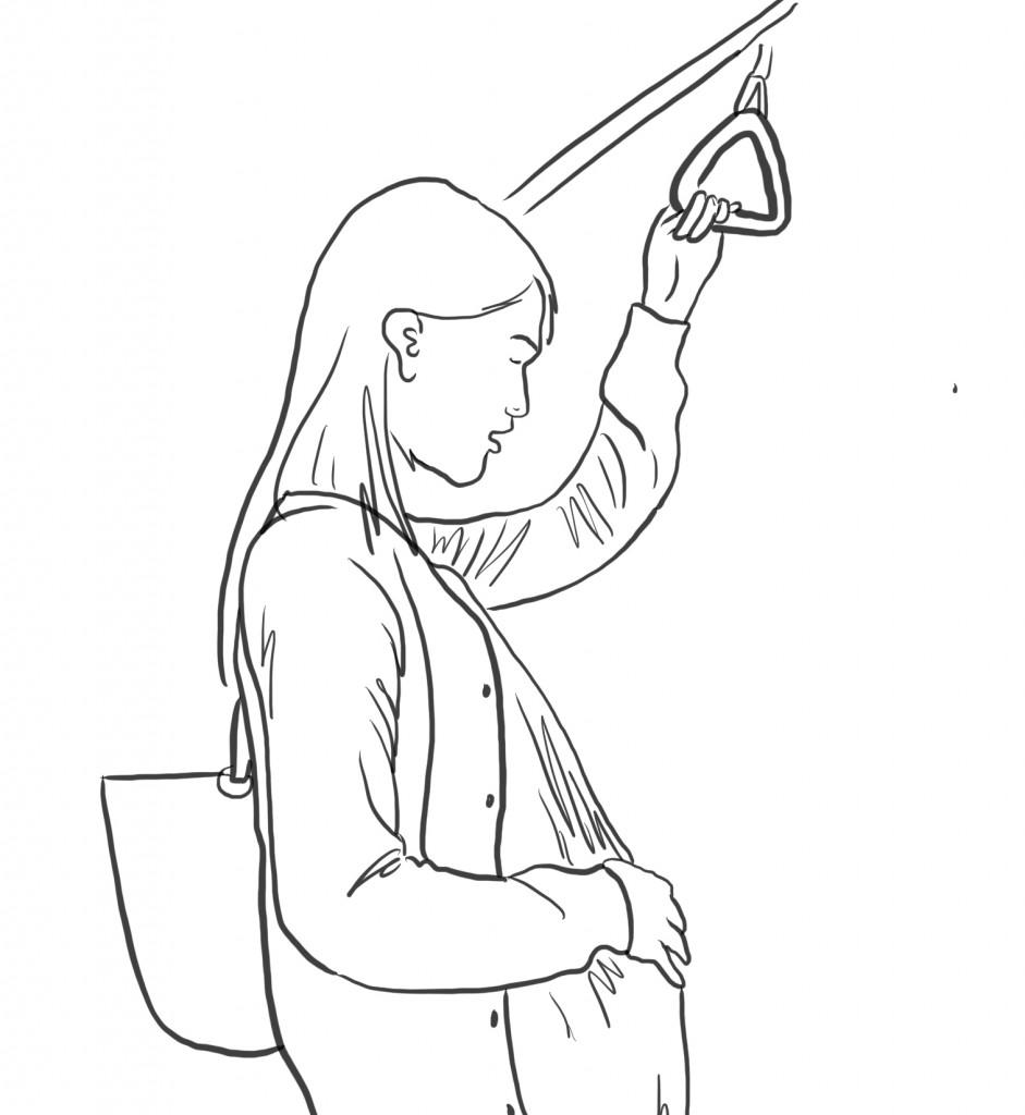 電車で立っている妊婦